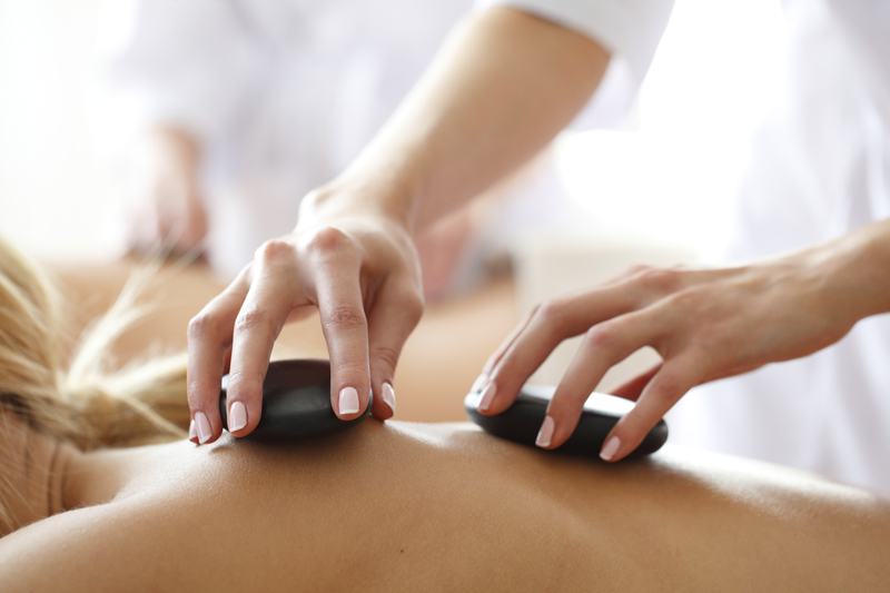 Thaw the Winter Stress with a Hot Stone Massage
